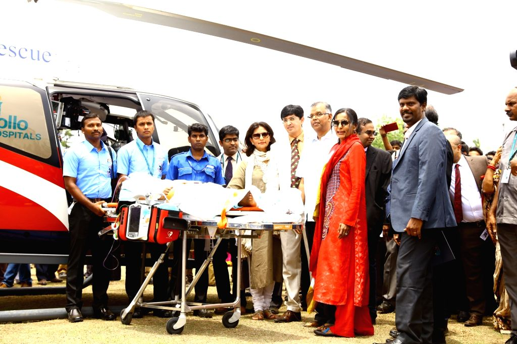 Apollo Hospitals Group Vice Chairperson Dr. Preetha Reddy and MD Sunita Reddy with  Air Ambulance crew in Chennai, on June 27, 2017. - Preetha Reddy and Sunita Reddy