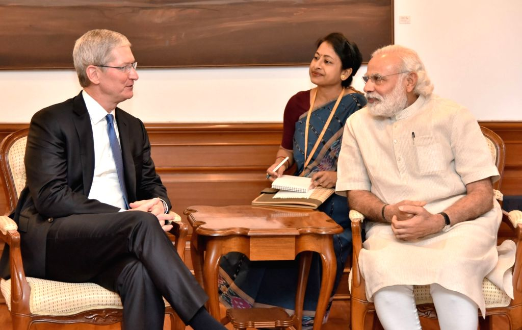 Apple CEO Tim Cook calls on Prime Minister Narendra Modi, in New Delhi on May 21, 2016. (File Photo: IANS/PIB) - Narendra Modi