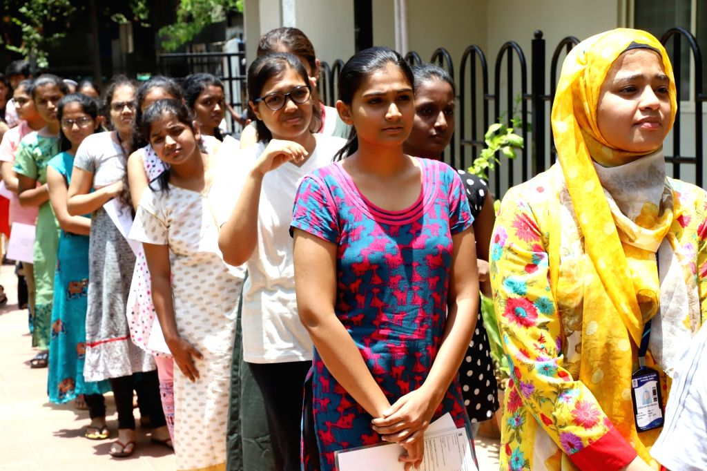 Applicants arrive outside their examination center to appear the National Eligibility cum Entrance Test NEET (UG) 2019 in Bengaluru, on May 5, 2019.