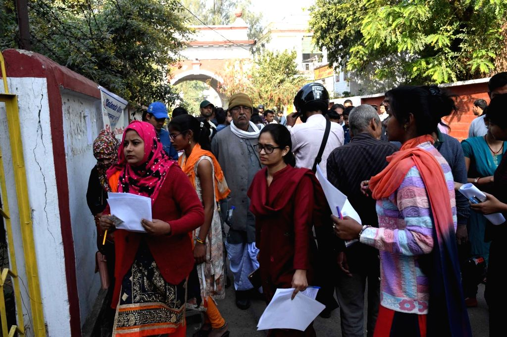Applicants arrive to appear for the state-level combined BEd entrance exam 2019 at an examination center in Patna, on March 10, 2019.