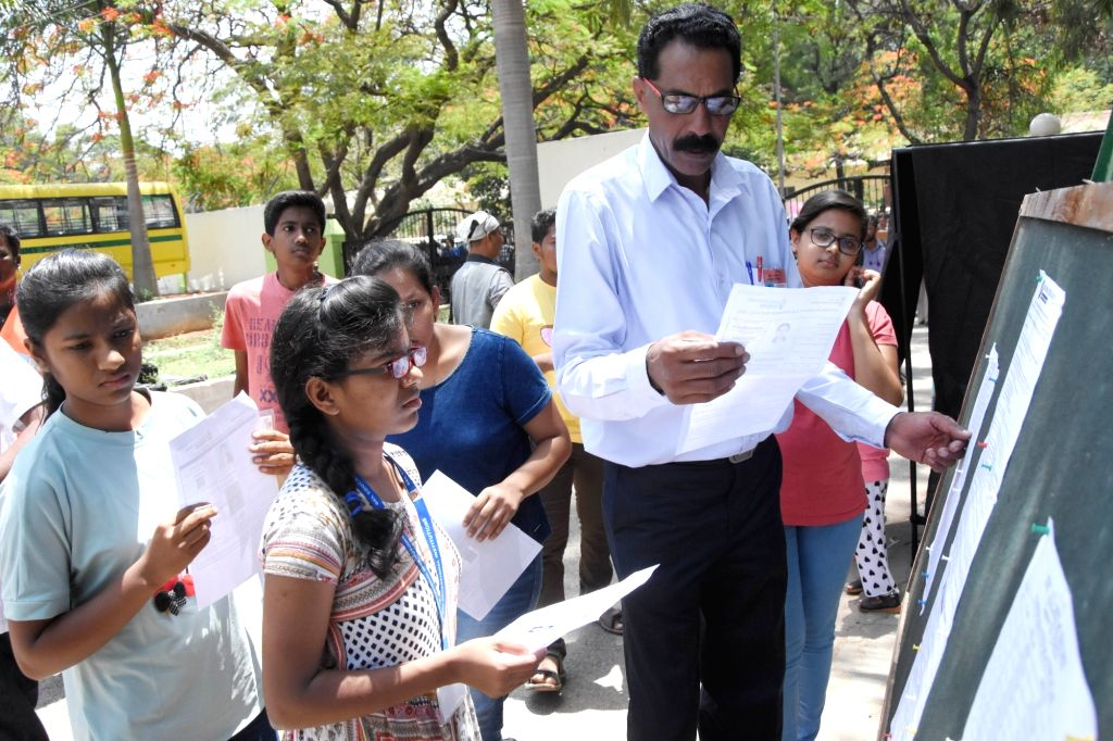 Applicants check seating arrangement outside their examination center as they arrive to appear for the National Eligibility cum Entrance Test NEET (UG) 2019 in Bengaluru, on May 5, 2019.