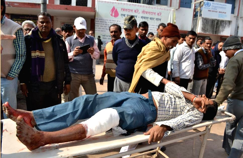 A person injured in a crude bomb blast at Ara civil court in Bhojpur district, about 60 km from Patna being taken for treatment on Jan 23, 2015. Three people, including a woman, a police ...