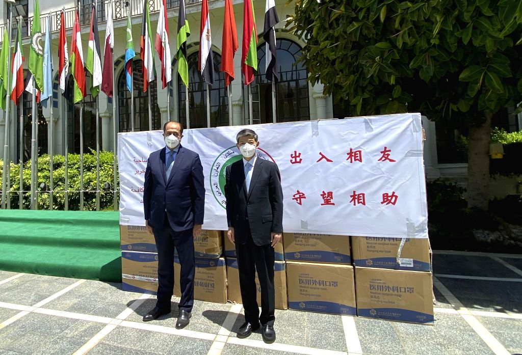 Arab League Assistant Secretary General Hossam Zaki (L) and Chinese Ambassador to Egypt Liao Liqiang pose for a photo during the medical aid handover ceremony at the ...