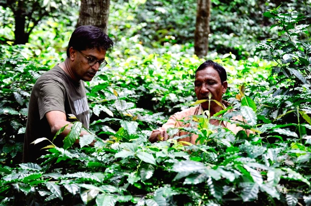 Araku co-founder & Naandi CEO Manoj Kumar with a farmer in Araku. - Manoj Kumar