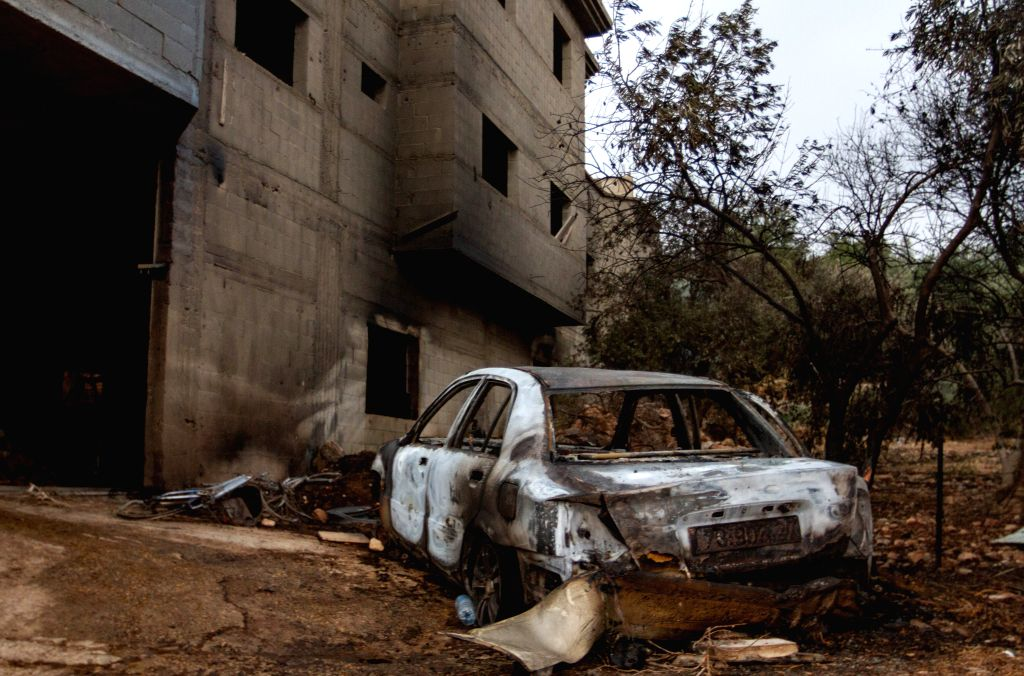 ARARA (ISRAEL), July 17, 2019 A burnt car is seen following a wildfire in the Arab town of Arara in northern Israel, on July 17, 2019. Wildfires broke out at several locations across ...