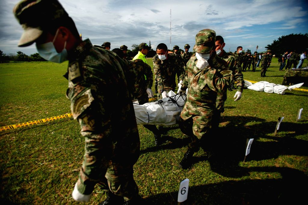 Soldiers carry the bodies of members of the National Liberation Army (ELN) killed during an operation of the military forces in the rural are of the Fortul ... - Juan Carlos Pinzon