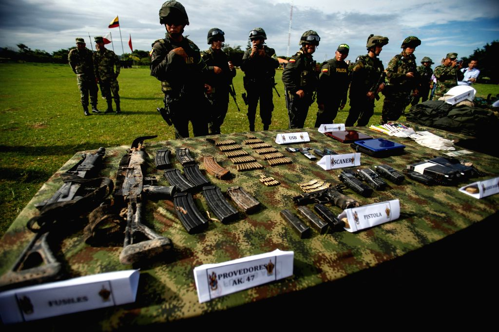 Soldiers guard seized guns and objects of members of the National Liberation Army (ELN) after an operation of the military forces in the rural are of the Fortul ... - Juan Carlos Pinzon