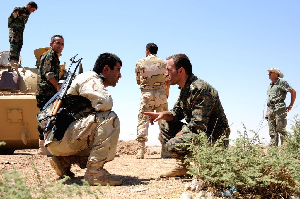Iraqi Kurdish soldiers prepare for a war in Dibega district near Arbil, Iraq, Aug. 8, 2014. U.S. aircraft bombed Islamic State artillery attacking Kurdish forces near .