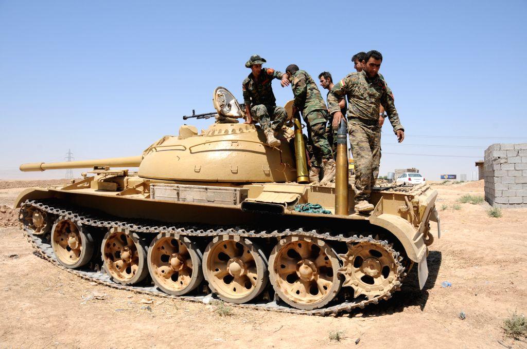 Iraqi Kurdish soldiers upload shells in Dibega district near Arbil, Iraq, Aug. 8, 2014. U.S. aircraft bombed Islamic State artillery attacking Kurdish forces near ...