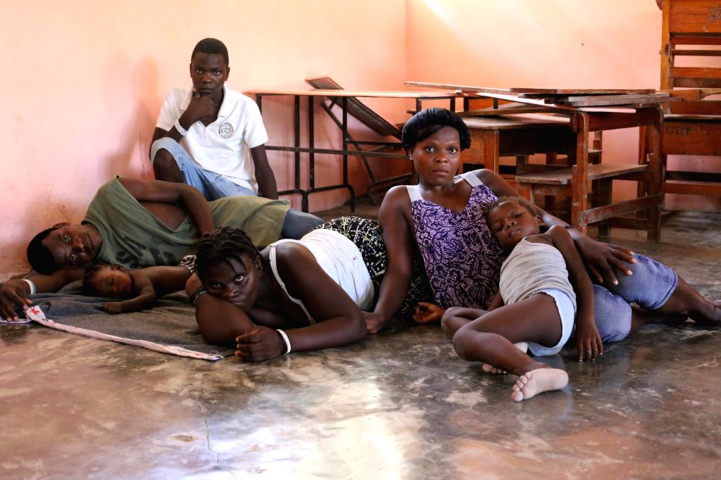 ARCAHAIE, Oct. 9, 2016 - Image provided by the United Nations Children's Fund (UNICEF) taken on Oct. 7, 2016 shows a family staying at a temporary shelter after the attack of Hurricane Matthew, in ...