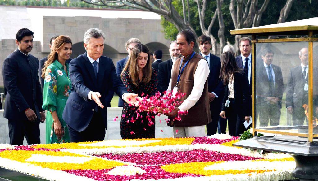 Argentina President Mauricio Macri along with first lady Juliana Awada pays floral tributes at the Samadhi of Mahatma Gandhi at Raj Ghat in New Delhi, on Feb 18, 2019. Also seen Union MoS ... - Rajyavardhan Singh Rathore