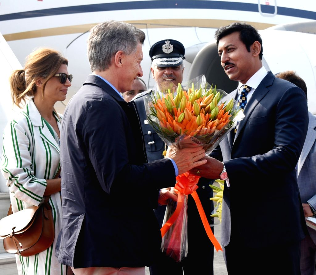 Argentina President Mauricio Macri being received by Union MoS Youth Affairs and Sports and Information and Broadcasting Rajyavardhan Singh Rathore, on his arrival, in New Delhi, on Feb ... - Rajyavardhan Singh Rathore