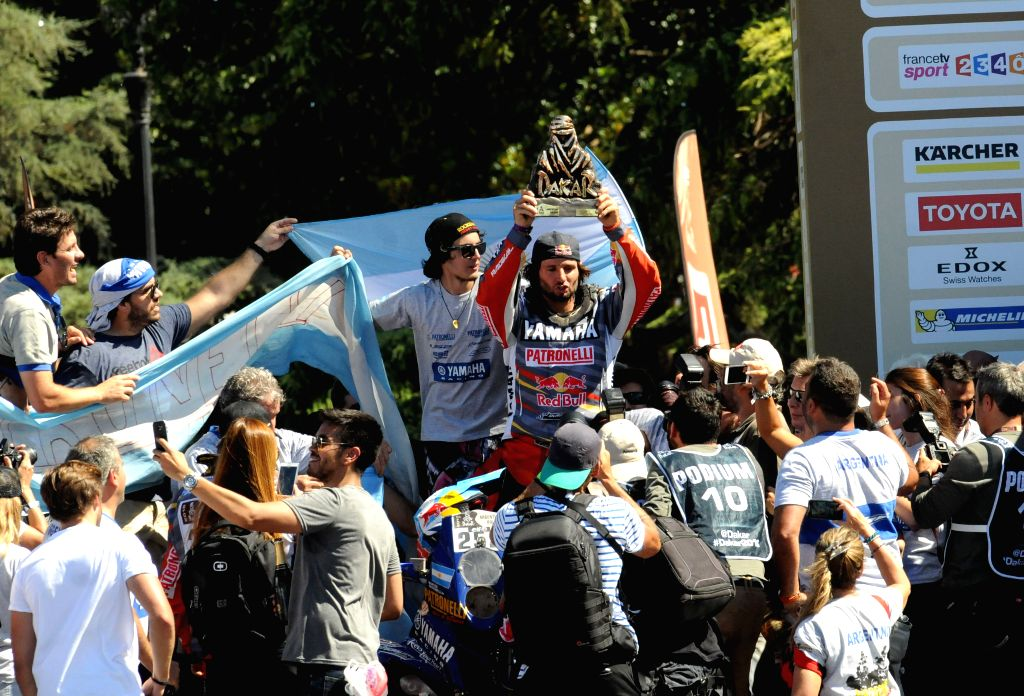 Argentina's driver of the quad category Marcos Patronelli (C) of Yamaha team, celebrates his third title at the end of the last stage of the 2016 Dakar Rally, in ...