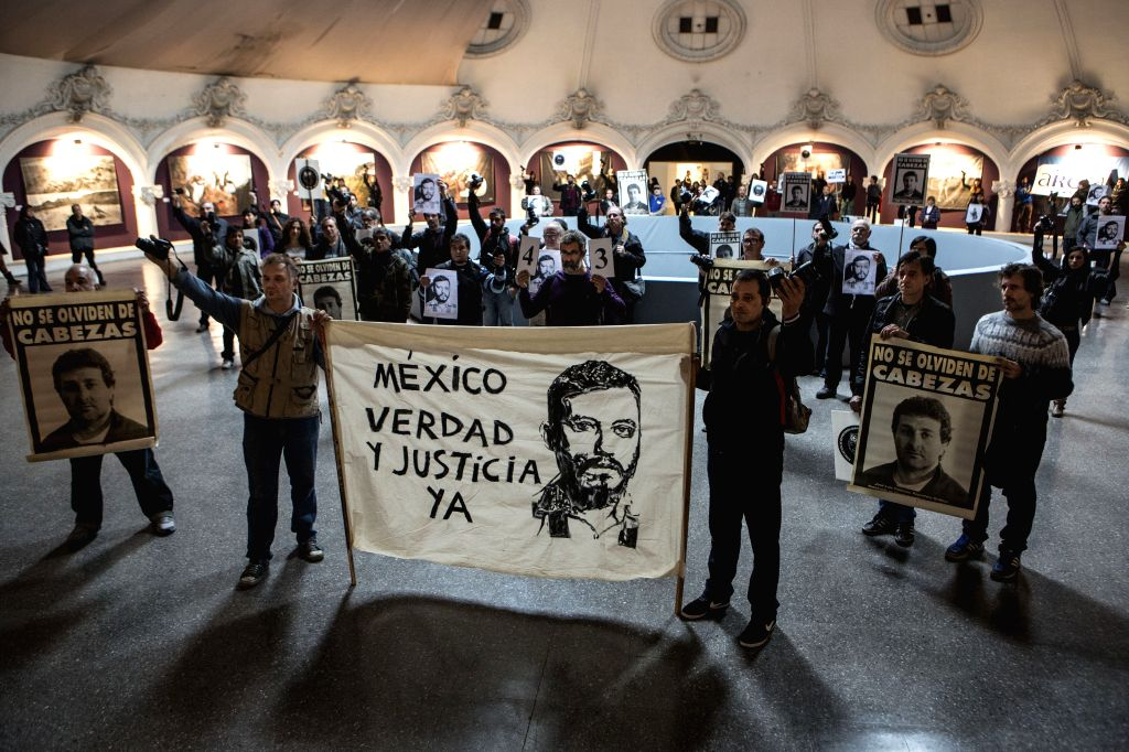 Argentine photojournalists hold banners during a demonstration against the murder of Mexican photojournalist Ruben Espinosa in the 26th Annual Argentine ...