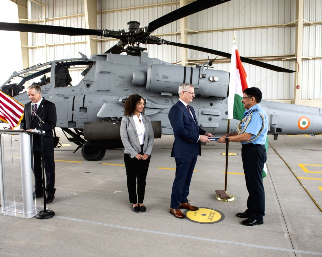 Arizona (US): Air Marshal A.S. Butola accepting the first AH-64E (I) Apache Guardian helicopter at a ceremony where the helicopter was formally handed over to the Indian Air Force (IAF) at Boeing ...