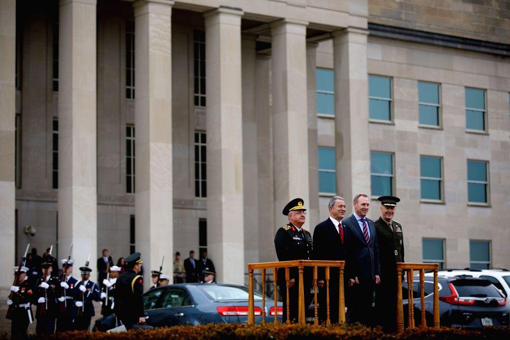 ARLINGTON (U.S.), Feb. 22, 2019 Acting U.S. Secretary of Defense Patrick Shanahan (2nd R, Front) welcomes Turkish Defense Minister Hulusi Akar (2nd L, Front) at the Pentagon in Arlington, ... - Hulusi Akar