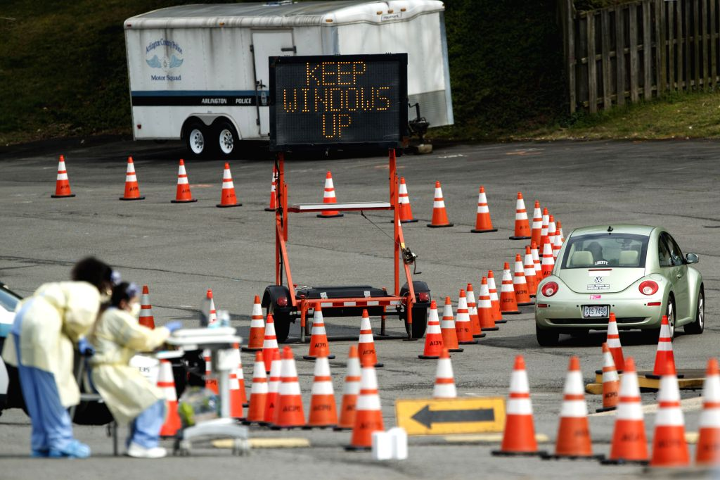 ARLINGTON (U.S.), March 19, 2020 A car is seen at a drive-through COVID-19 testing location set up by the Virginia Hospital Center in Arlington, Virginia, the United States, on March 19, ...