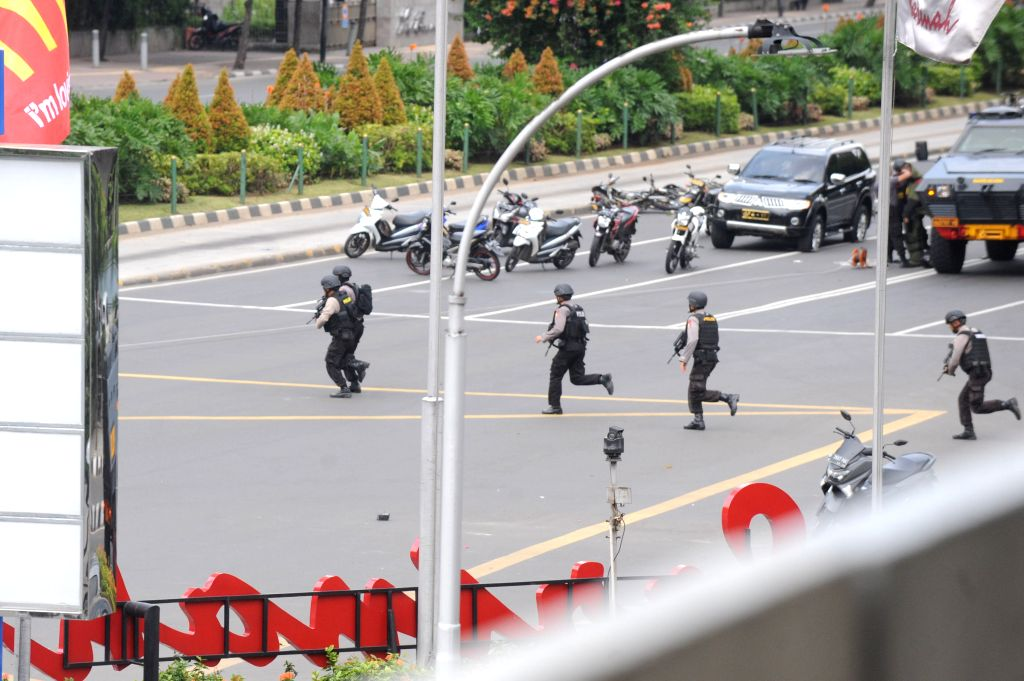Armed police officers run on a street in Jakarta, Indonesia, Jan. 14, 2016. Indonesian President Joko Widodo on Thursday condemned the attacks in the nation's ...