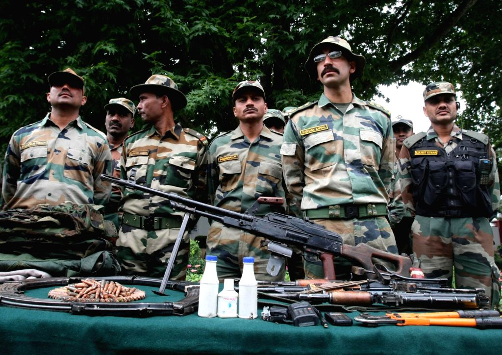 Arms and ammunitions recovered by the Indian Army near LOC being displayed in Srinagar on August 16, 2013. (Photo::: IANS)