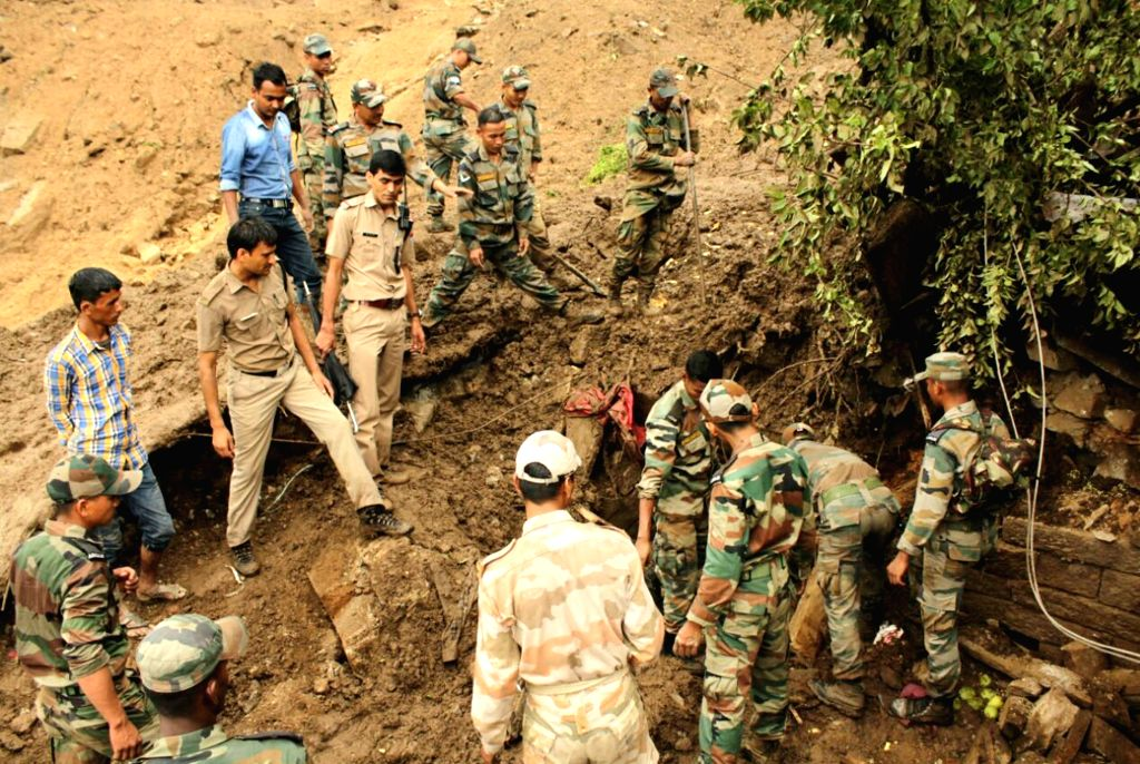 Army and police personnel during a rescue operation in Pithoragarh of Uttarakhand on on July 2, 2016.
