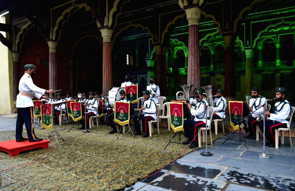 Army Band members perform to honour the COVID-19 warriors as they take part in rehearsals for the upcoming Independence Day celebrations at Tippu Sultan's summer palace, in Bengaluru on ...