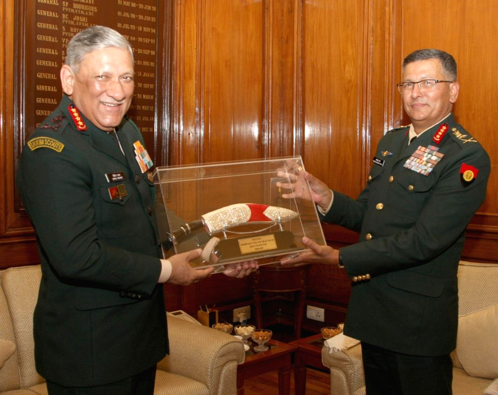 Army Chief General Bipin Rawat presents the Memento to the Nepal Army Chief General Purna Chandra Thapa, in New Delhi, on Jan 12, 2019.