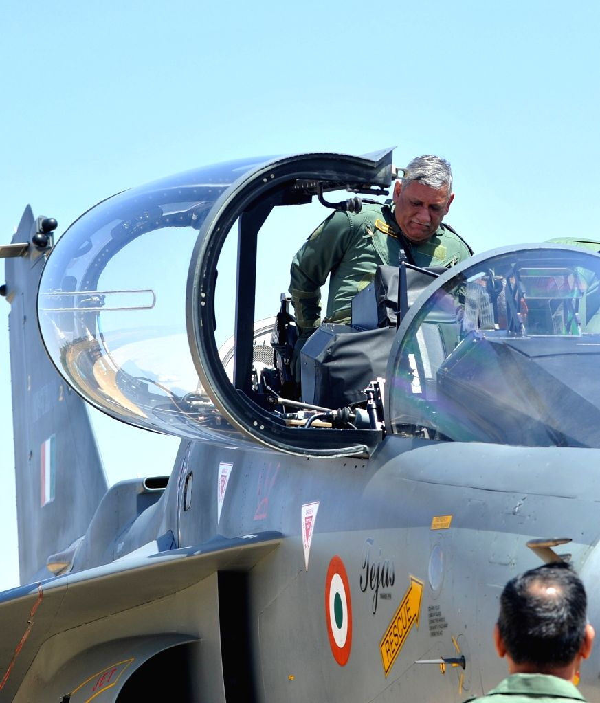 "Army chief General Bipin Rawat ready to Tejas fighter aircraft during ""Aero India 2019"" - air show at Yelahanka Air Force Station, in Bengaluru, on Feb 21, 2019."