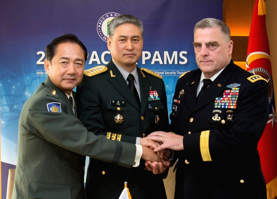 Army chiefs of South Korea, U.S. and Japan meet on the sidelines of the Pacific Armies Chiefs Conference in Seoul on Sept. 19, 2017, in this photo from the South Korean Army. Pictured are Gen. ...