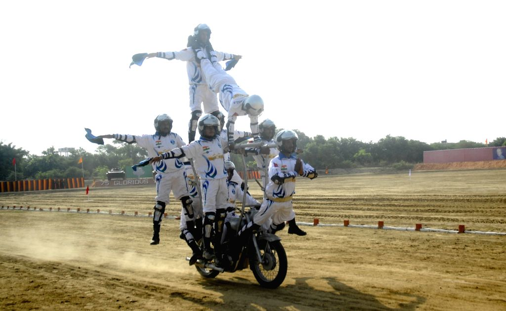 Army Dare Devils display their skills during Platinum Jubilee celebration of 8th Mechanised Infantry at Khasa near Amritsar on Sept 16, 2016.