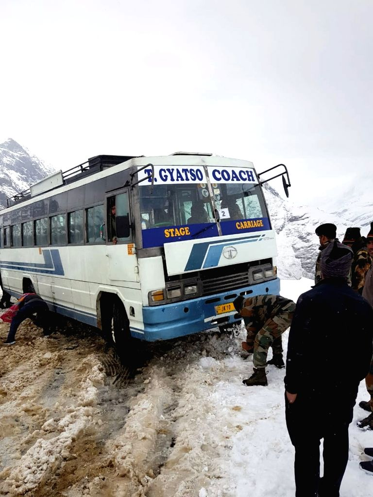 Army personnel clear snow on Rohtang Pass, Himachal Pradesh on Oct 7, 2019.