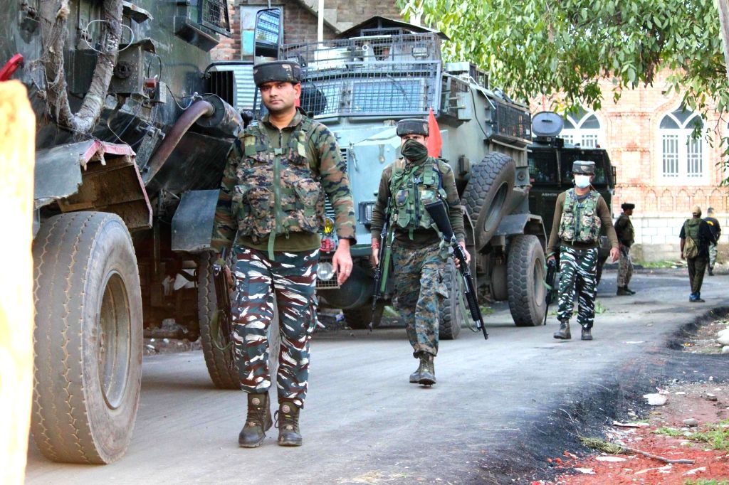 Army personnel conduct cordon and search operations after four terrorists were killed in an encounter with the security forces in South Kashmir's Shopian district on Aug 28, 2020. One ...