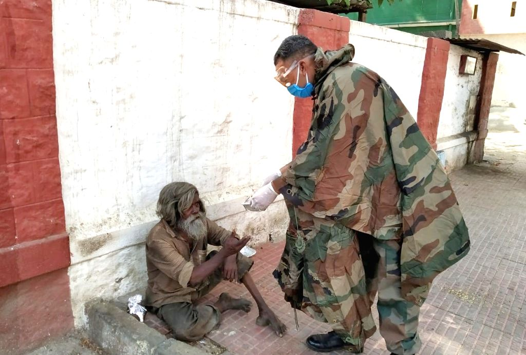 Army personnel distribute food packages among the needy on Day 5 of the 21-day countrywide lockdown imposed to contain the spread of novel coronavirus, in Bengaluru on March 29, 2020.