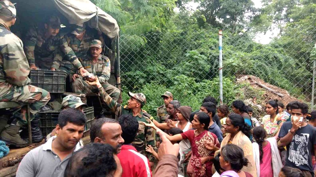 Army personnel distribute food packets to flood victims in Hyderabad on Sept 24, 2016.