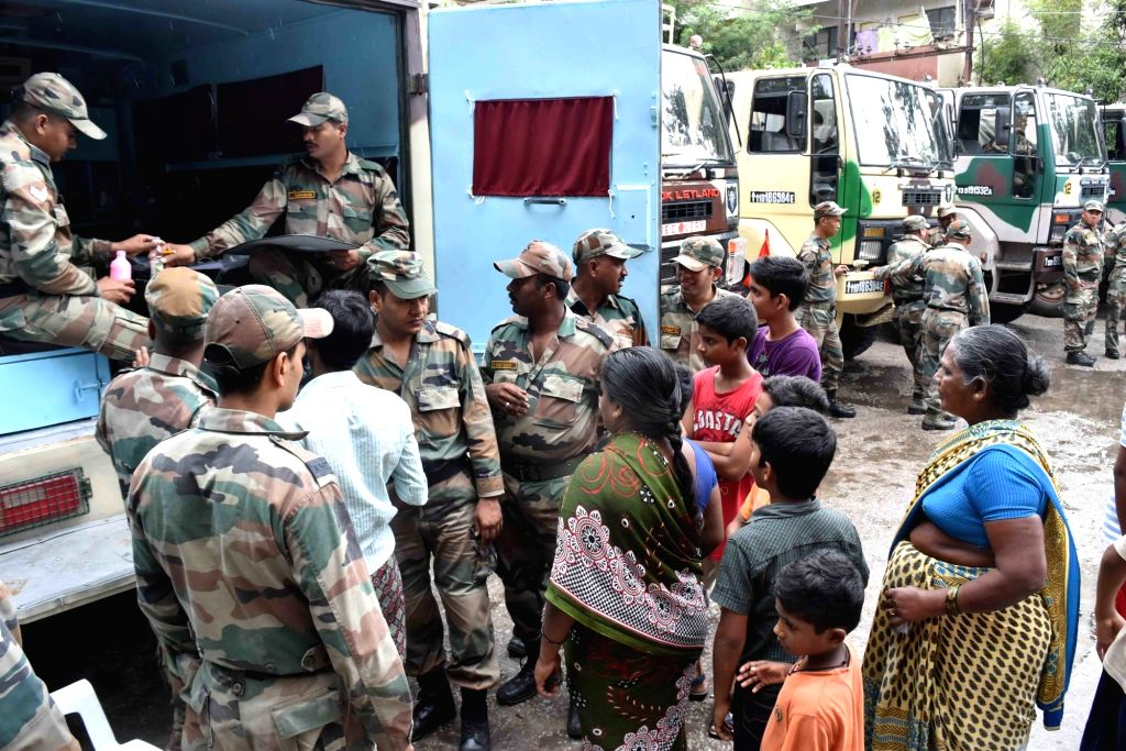 Army personnel distribute medicines to flood victims in Hyderabad on Sept 24, 2016.