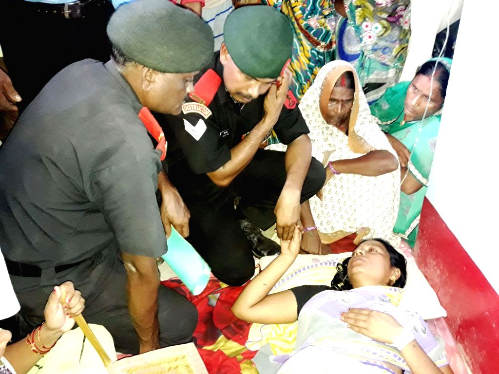 Army personnel meet wife of Havildar Ashok Kumar Singh who was killed in the terror attack on Uri army camp in Bhojpur Distrisct of Bihar on Sept 20, 2016.