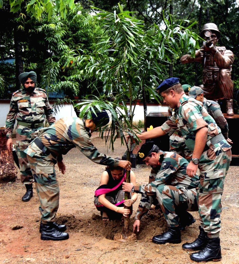 Army personnel plant saplings to mark 'Vanamahotsav' - forest festival- at Mahim Nature Park in Mumbai on July 1, 2016.