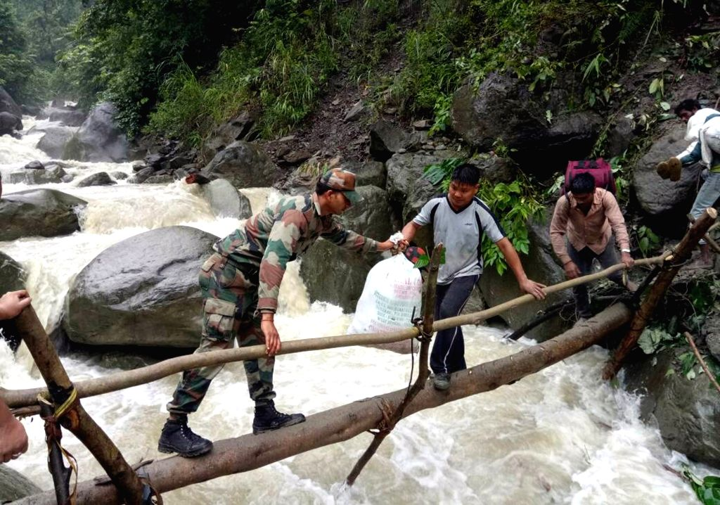 Army personnel rescue people from a landslide site in Bhalukpong of Arunachal Pradesh on June 21, 2017.