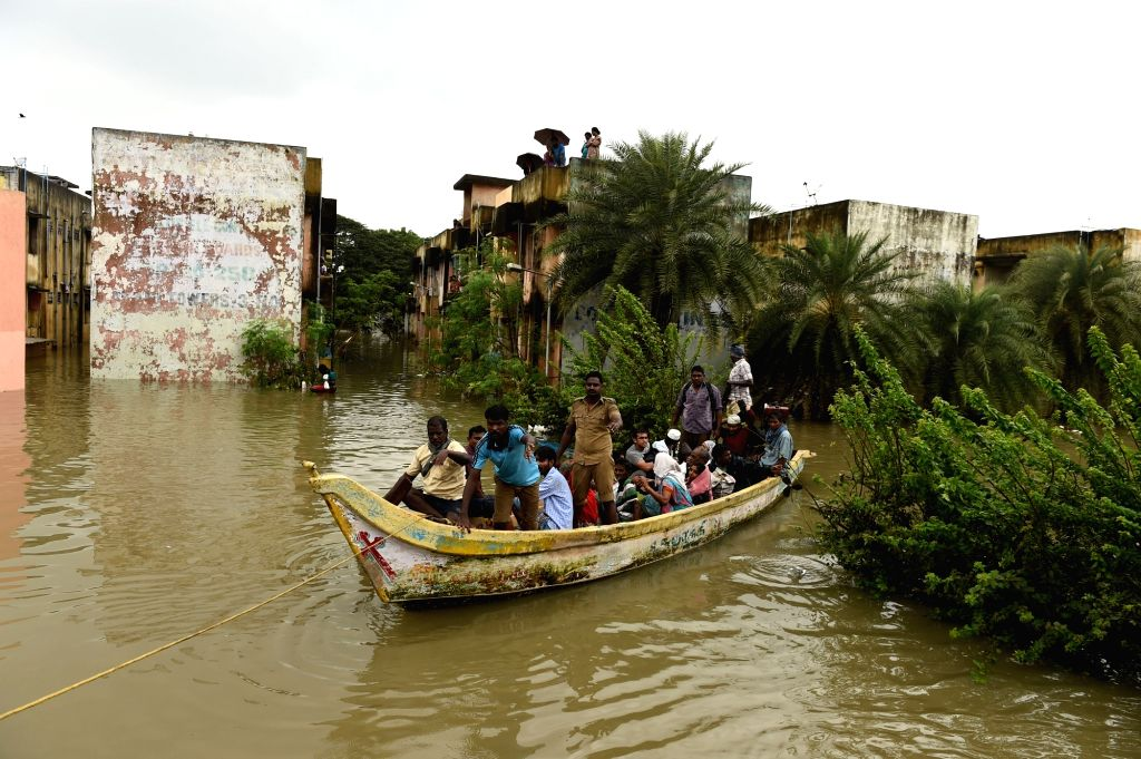 Army personnel rescue people from submerged houses in Chennai on Dec. 3, 2015.