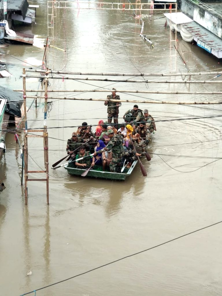 Army personnel rescue people in flood affected areas of Kota and Jhalawad.