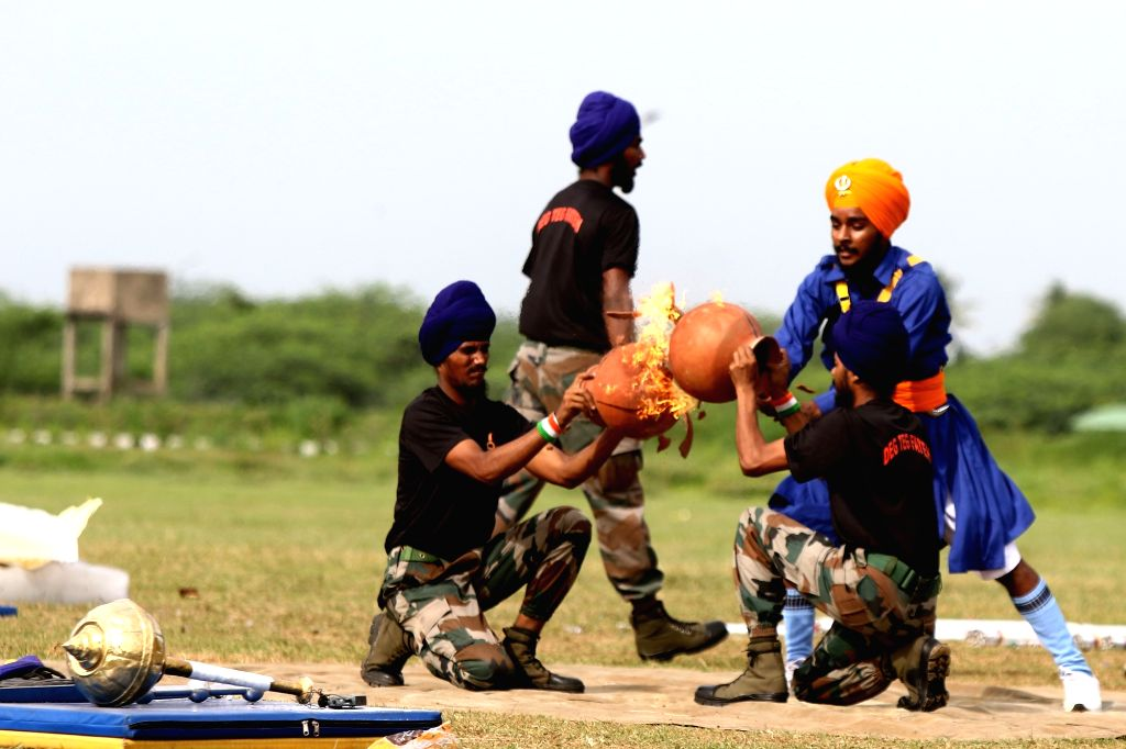 Army personnel show their skills at a combined display of martial arts and various adventure activities at Officers' Training Academy, in Chennai on Sep 6, 2019.