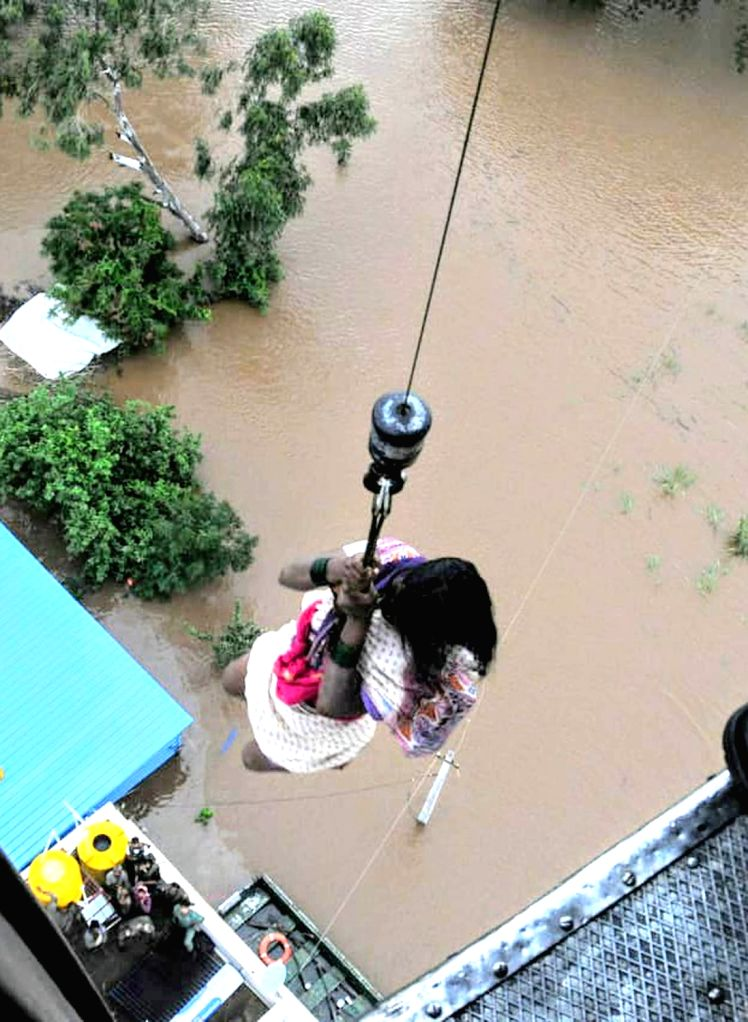 Army rescue a woman from flood hit Gokak in Karnataka's Belagavi district on Aug 9, 2019.