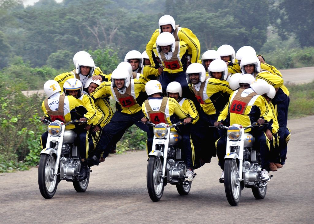 Army Service Corps (ASC) motor cycle team `Tornadoes` display their skills in Bengaluru on Nov 15, 2015.