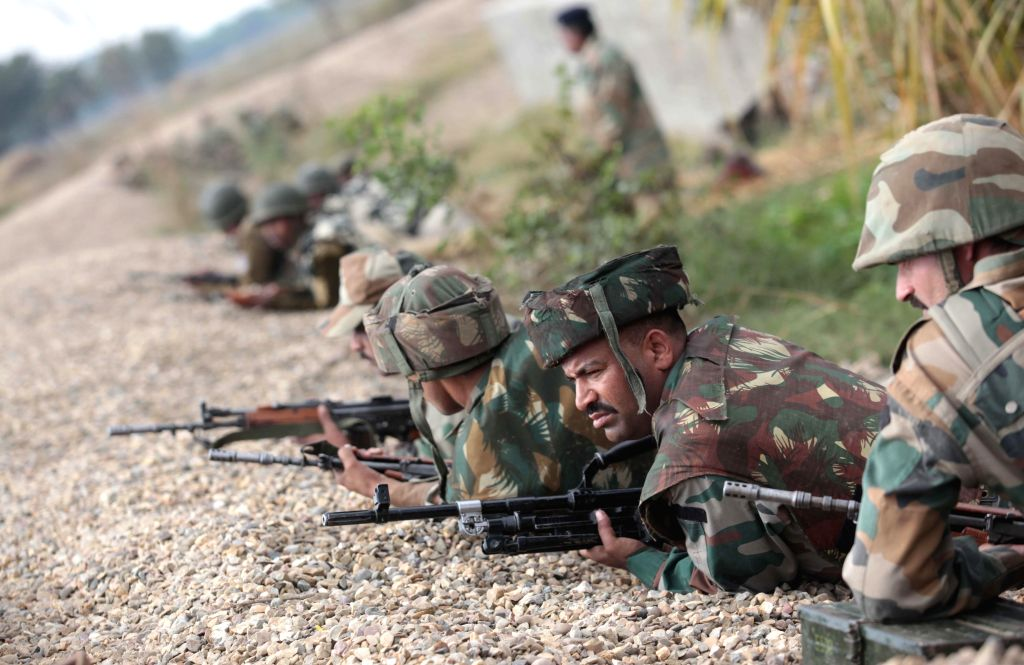 Army personnel enter a tank during an encounter with heavily armed militants who sneaked into the Indian side of the border from Pakistan Thursday (27th November), at Arnia in Jammu district ..