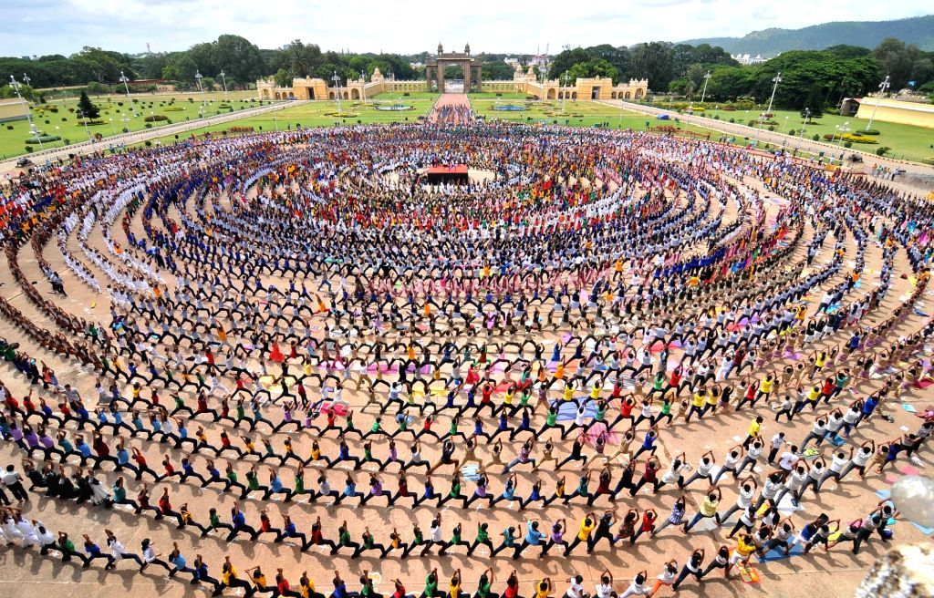 Around 6,001 students from 15 educational institutions participate in the longest yoga chain arranged by the District Administration and Mysore Palace Board at the Mysore Palace as part of ...