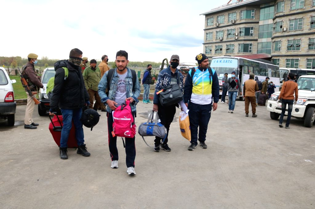 Around 78 travellers who had returned from Leh and were put under 14-day quarantine in Srinagar being sent back home after completing the quarantine period amid coronavirus pandemic, on Apr ...