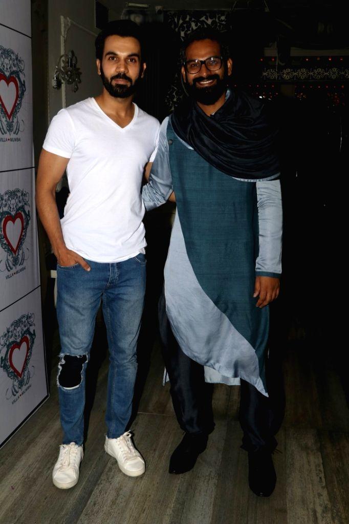 Art director Saini Johray and actor Raj Kumar Yadav during the birthday celebrations of art director Saini Johray in Mumbai on June 28, 2016. - Saini Johray and Kumar Yadav