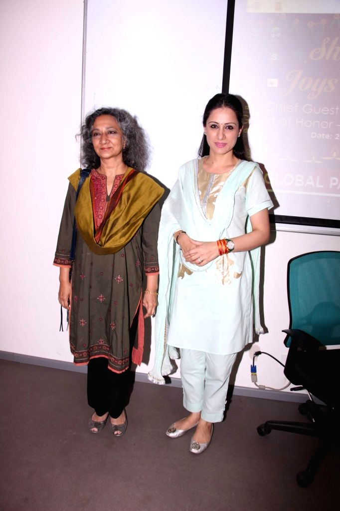 Artist and Muralist Rouble Nagi and social activist Sumaira Abdulali during an art camp for the underpriviled children, in Mumbai on Oct 28, 2016.