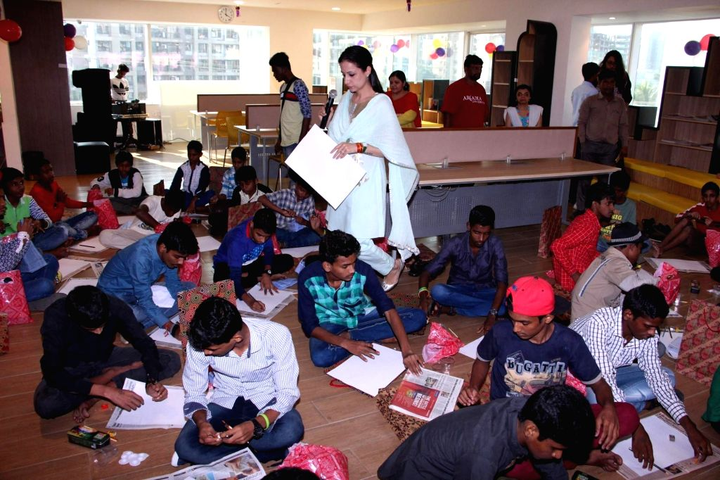 Artist and Muralist Rouble Nagi during an art camp for the underpriviled children, in Mumbai on Oct 28, 2016.