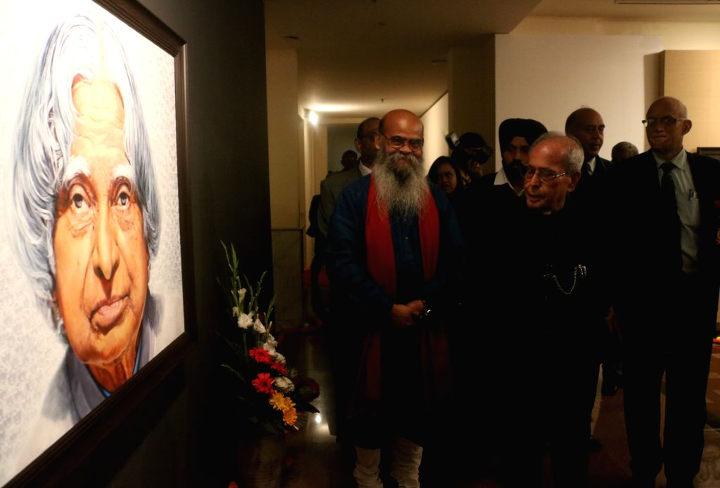 Artist Dipak Kumar Ghosh with Former President Pranab Mukherjee at the portrait of A. P. J. Abdul Kalam during a portrait exhibition in New Delhi on Feb 3. 2018. - Dipak Kumar Ghosh and Pranab Mukherjee