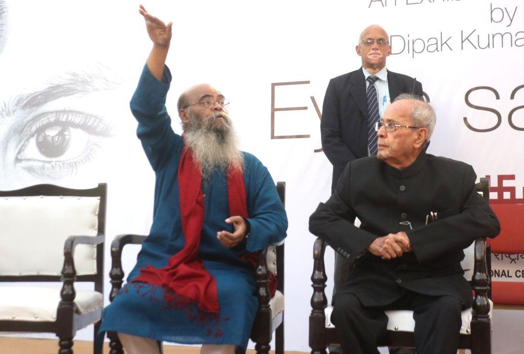 Artist Dipak Kumar Ghosh with Former President Pranab Mukherjee during a portrait exhibition in New Delhi on Feb 3. 2018. - Dipak Kumar Ghosh and Pranab Mukherjee
